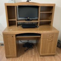 Desk for computer with pull out work area and storage. In good condition.