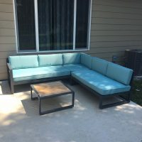 Outdoor sectional sofa with table